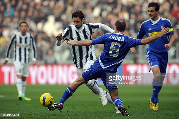 Mirko Vucinic of Juventus FC is challenged by Maurizio Lauro of AC Cesena during the Serie A match between Juventus FC and AC Cesena on December 4...