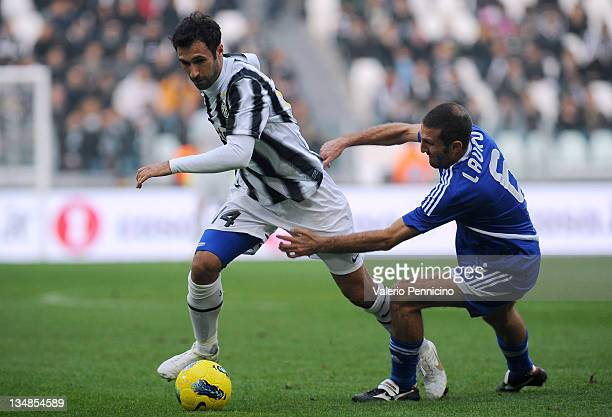 Mirko Vucinic of Juventus FC turns Maurizio Lauro of AC Cesena during the Serie A match between Juventus FC and AC Cesena on December 4 2011 in Turin...