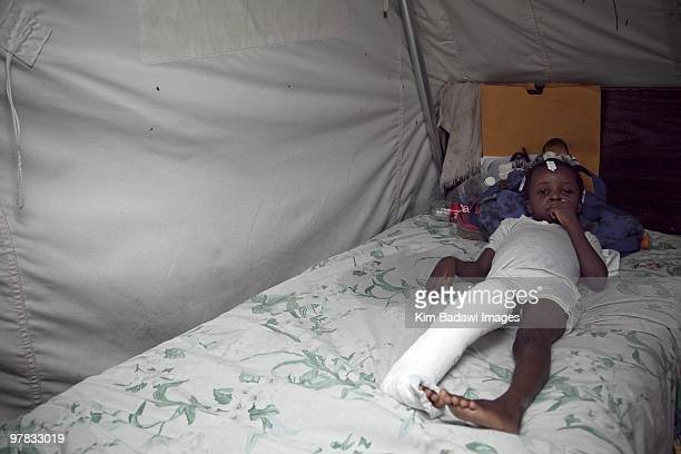 Mirliane Pierre earthquake survivor at the Red Cross medical observation tent inside General Hospital on February 8 2010 in PortauPrince Haiti...