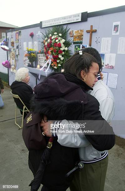 Mirna Almonte who lost her brother in the crash of American Airlines Flight 587 hugs her husband Domingo during memorial for victims of the crash at...