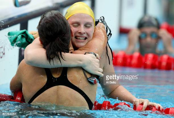 Mirna Jukic of Austria congratulates Leisel Jones of Australia on finishing the Women's 100m Breaststroke Final in first place and wins the gold...