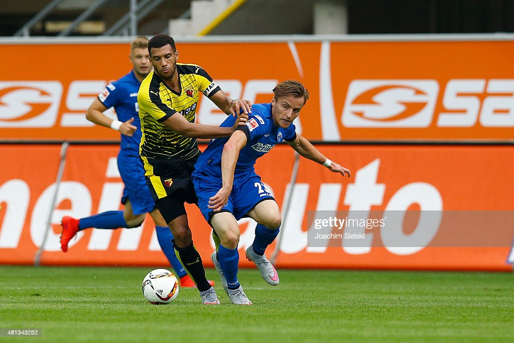 Mirnes Pepic of Paderborn challenges Etienne Capoue of Watford during the pre-season friendly match between SC Paderborn and Watford FC at Benteler Arena on July 19, 2015 in Paderborn, Germany.