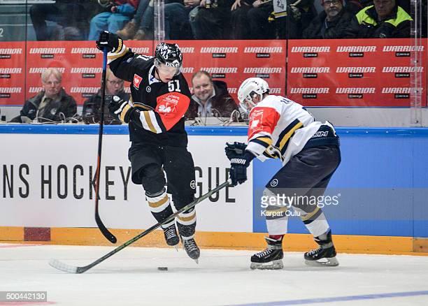 Miro Aaltonen of Karpat Oulu competes for the puck with Otso Rantakari of Espoo Blues during the Champions Hockey League quarter final between Karpat...