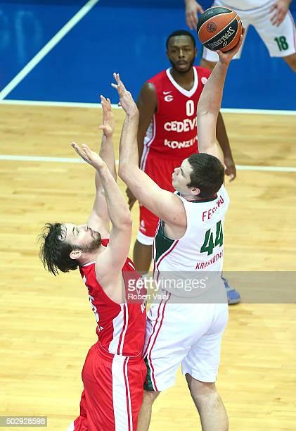 Miro Bilan #15 of Cedevita Zagreb competes with Kyrylo Fesenko #44 of Lokomotiv Kuban Krasnodar during the Turkish Airlines Euroleague Basketball Top...