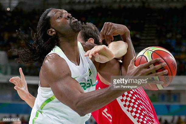 Miro Bilan of Croatia fouls Nene Hilario of Brazil during the Men's Basketball Preliminary Round Group B Brazil vs Croatia on Day 6 of the Rio 2016...