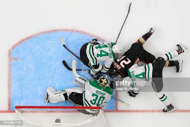 Miro Heiskanen Gavin Bayreuther and Ben Bishop of the Dallas Stars defend against Pontus Aberg of the Anaheim Ducks during the third period of a game...