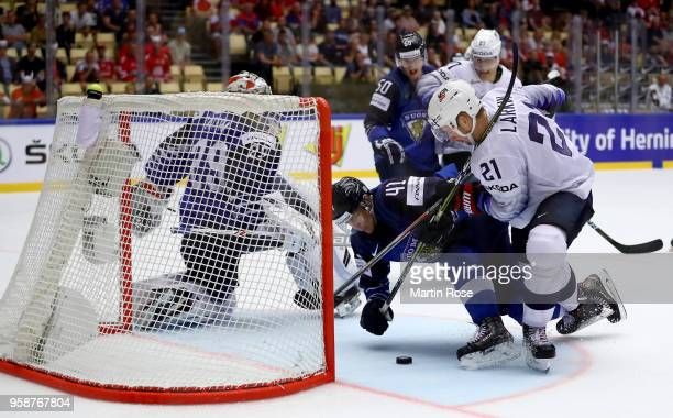 Miro Heiskanen of Finland and Dylan Larkin of the United States battle for the puck during the 2018 IIHF Ice Hockey World Championship Group B game...