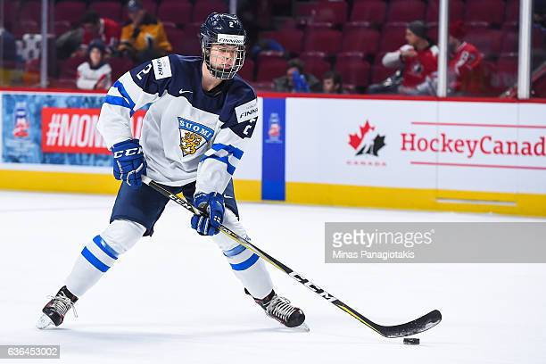 Miro Heiskanen of Team Finland skates the puck during the warmup prior to the IIHF exhibition game against Team Canada at the Bell Centre on December...