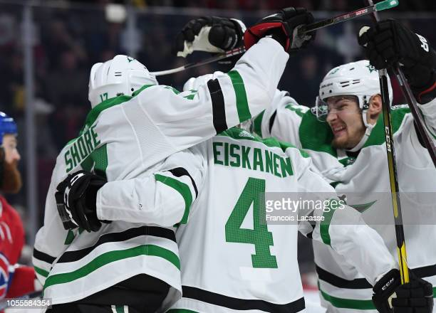 Miro Heiskanen of the Dallas Stars celebrates with teammates after scoring a goal against the Montreal Canadiens in the NHL game at the Bell Centre...