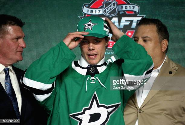 Miro Heiskanen third overall pick of the Dallas Stars puts on his hat onstage during Round One of the 2017 NHL Draft at United Center on June 23 2017...