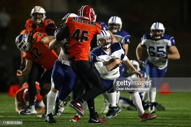 Miro Kadmiry of Finland runs at the Dutch defense during the IFAF 2020 European Championship Qualification European Division C match between...