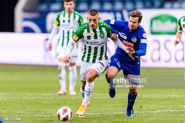 Miro Muheim of St. Gallen fights for the ball with Louis Schaub of Luzern during the match between FC Luzern and St. Gallen at Swissporarena on...