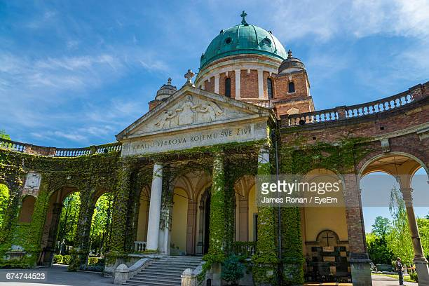 mirogoj cemetery against sky in city - zagreb stock pictures, royalty-free photos & images