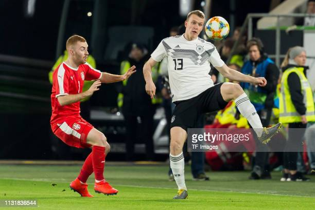 Miroslav Bogosavac of Serbia and Stefan Mitrovic of Serbia battle for the ball during the International Friendly match between Germany and Serbia at...