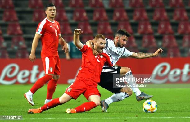 Miroslav Bogosavac of Serbia competes for the ball with Marco Richter of Germany during the 2019 UEFA U21 Group B match between Germany and Serbia at...