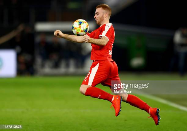 Miroslav Bogosavac of Serbia runs with the ball during the International Friendly match between Germany and Serbia at Volkswagen Arena on March 20...