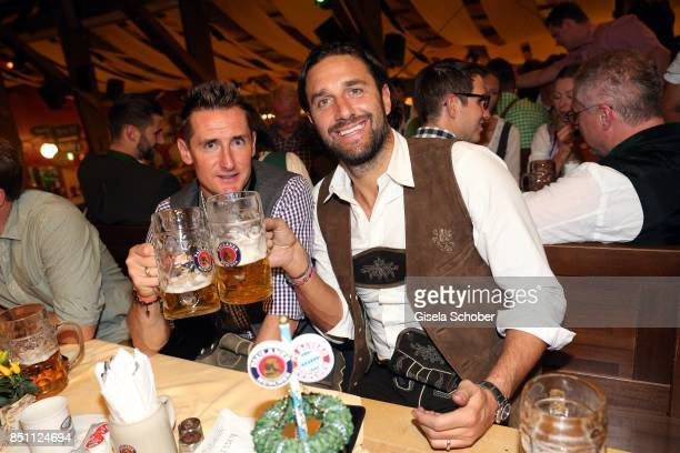 Miroslav Klose and Luca Toni former FC Bayern soccer player during the Oktoberfest at Winzerer Faehndl tent at Theresienwiese on September 21 2017 in...