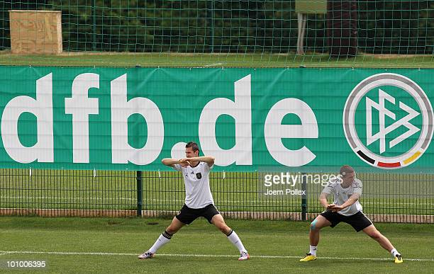 Miroslav Klose and Lukas Podolski of Germany exercise during a training session at Sportzone Rungg on May 27, 2010 in Appiano sulla Strada del Vino,...