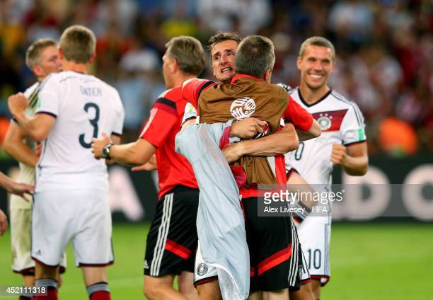 Miroslav Klose and players and staffs of Germany celebrate the win after the 2014 FIFA World Cup Brazil Final match between Germany and Argentina at...