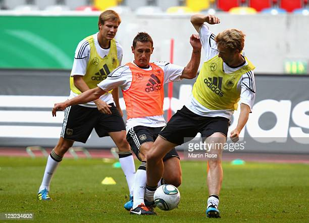 Miroslav Klose and Simon Rolfes battle for the ball during the German National team training session at esprit Arena on September 1 2011 in...