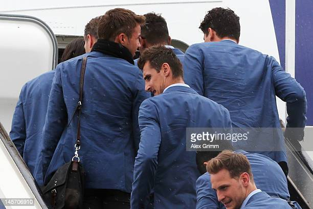 Miroslav Klose and team mates of the German national football team walk into the airplane prior to their departure to their Euro 2012 base camp in...