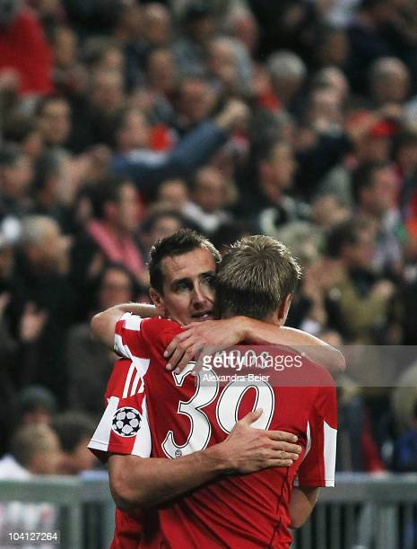 Miroslav Klose and Toni Kroos of Bayern celebrate his first goal during the UEFA Champions League group E match between FC Bayern Muenchen and AS...