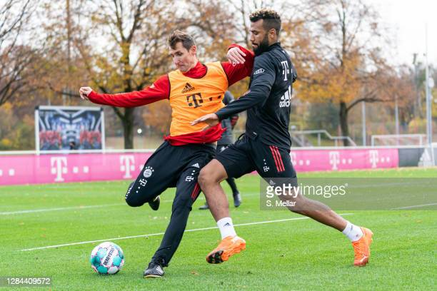 Miroslav Klose assistant coach of Bayern Muenchen is challenged by Eric Maxim ChoupoMoting of FC Bayern Muenchen during a training session at...