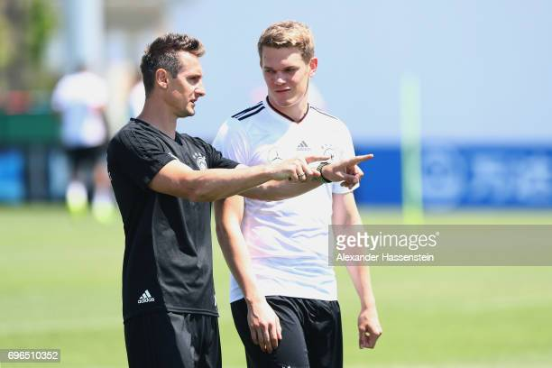 Miroslav Klose assistent coach of the German national team talks to his player Matthias Ginter during a training session at Park Arena training...