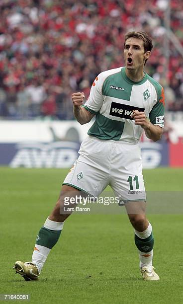 Miroslav Klose celebrates scoring the fifth goal Werder Bremen at the AWD Arena on August 13, 2006 in Hanover, Germany.