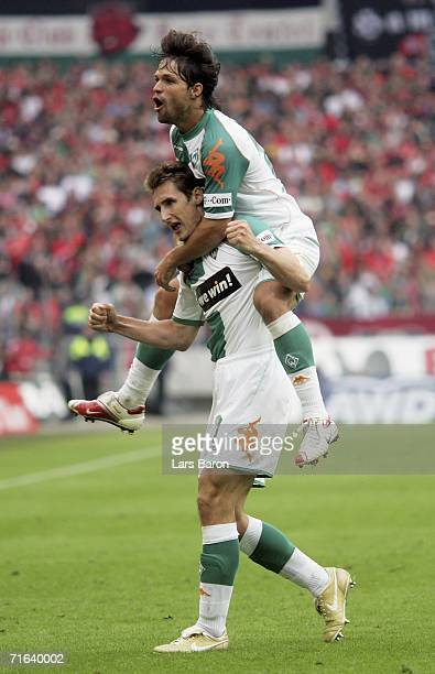 Miroslav Klose celebrates scoring the fifth goal with team mate Diego during the Bundesliga match between Hanover 96 and Werder Bremen at the AWD...