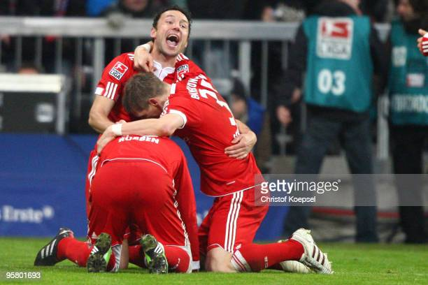 Miroslav Klose celebrates the second goal with Mark van Bommel and Bastian Schweinsteiger during the Bundesliga match between Bayern Muenchen and...