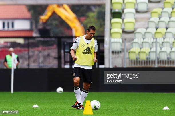 Miroslav Klose controls the ball during a Germany training session ahead of their friendly match against Poland at Baltic Arena on September 5, 2011...