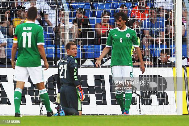 Miroslav Klose goalkeeper MarcAndre ter Stegen and Mats Hummels of Germany react after Eren Derdiyok of Switzerland scored his team's third goal...