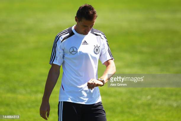 Miroslav Klose looks at his watch during a Germany training session at Campo Sportivo Comunale Andrea Corda on May 17 2012 in Abbiadori Italy