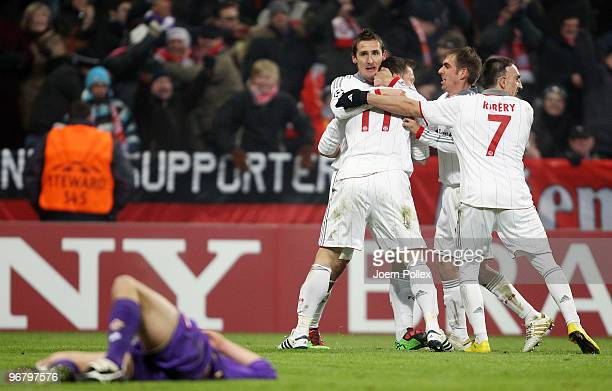 Miroslav Klose of Bayern celebrates scoring his team's second goal with team mates Ivica Olic Philipp Lahm and Franck Ribery while a player of...