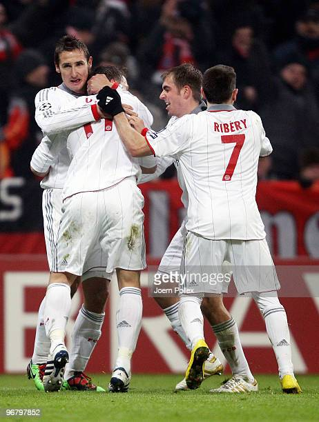 Miroslav Klose of Bayern celebrates scoring his team's second goal with team mates Ivica Olic Philipp Lahm and Franck Ribery during the UEFA...
