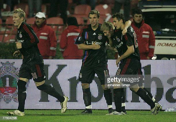 Miroslav Klose of Bayern celebrates with his teammates Bastian Schweinsteiger, Lukas Podolski and Toni Kross after scoring 2-2 during the UEFA Cup...