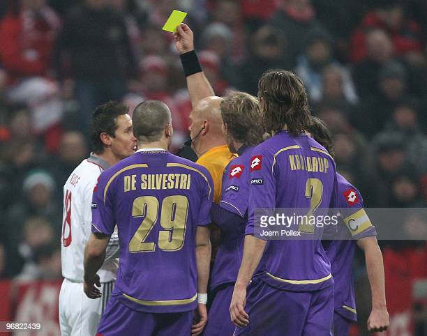 Miroslav Klose of Bayern gets a yellow card from Referee Tom Henning Ovrebo during the UEFA Champions League round of sixteen, first leg match...