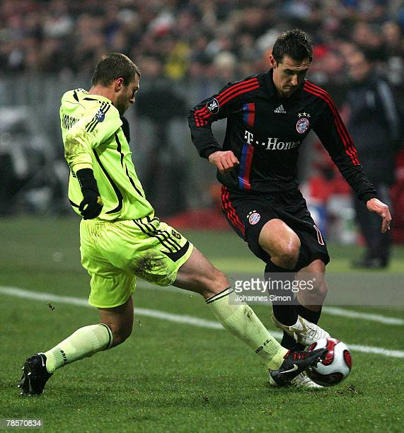 Miroslav Klose of Bayern in action with Avraam Papadopoulos of Saloniki during the UEFA Cup Group F match between Bayern Munich and Aris Saloniki at...