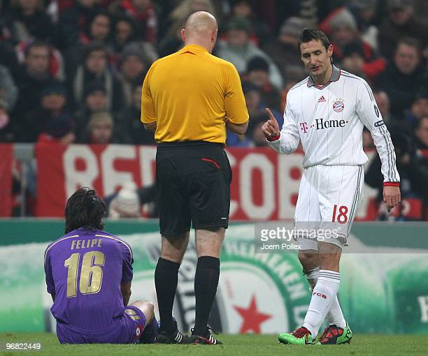 Miroslav Klose of Bayern talks to Referee Tom Henning Ovrebo after his yellow card during the UEFA Champions League round of sixteen, first leg match...