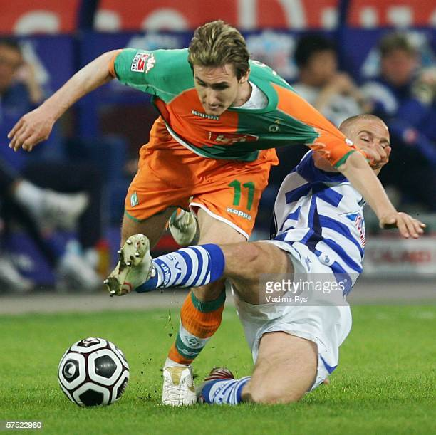 Miroslav Klose of Bremen and Peter van Houdt of Duisburg battle for the ball during the Bundesliga match between MSV Duisburg and Werder Bremen at...