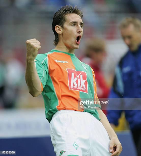 Miroslav Klose of Bremen celebrates scoring his goal during the Bundesliga match between Werder Bremen and Arminia Bielefeld at the Weser Stadium on...