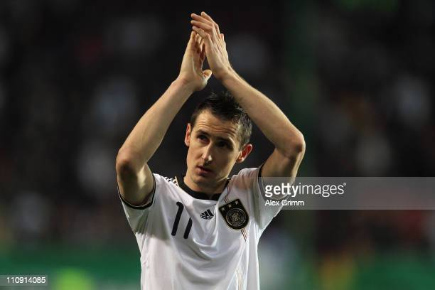 Miroslav Klose of Germany applauds to supporters after the EURO 2012 Group A qualifier match between Germany and Kazakhstan at Fritz-Walter-Stadium...