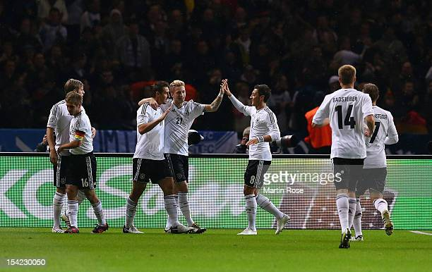 Miroslav Klose of Germany celebrate with his team mates after he scores his team's opening goal during the FIFA 2014 World Cup Qualifier group C...