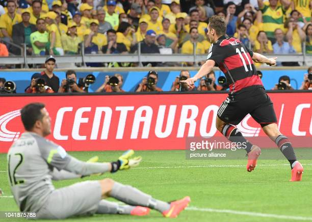 Miroslav Klose of Germany celebrates after scoring the 0-2 goal against goalkeeper Julio Cesar of Brazil during the FIFA World Cup 2014 semi-final...