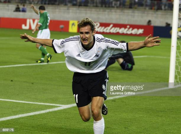 Miroslav Klose of Germany celebrates after scoring the first goal during the Germany v Republic of Ireland Group E World Cup Group Stage match played...