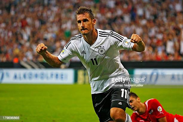 Miroslav Klose of Germany celebrates after scoring the opening goal of the FIFA 2014 World Cup Qualifying Group C match between Germany and Austria...