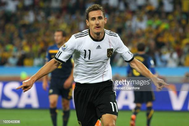 Miroslav Klose of Germany celebrates as he scores his side's second goal during the 2010 FIFA World Cup South Africa Group D match between Germany...
