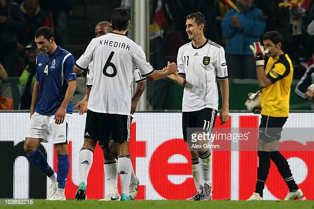Miroslav Klose of Germany celebrates his team's fifth goal with team mate Sami Khedira during the EURO 2012 Group A Qualifier match between Germany...