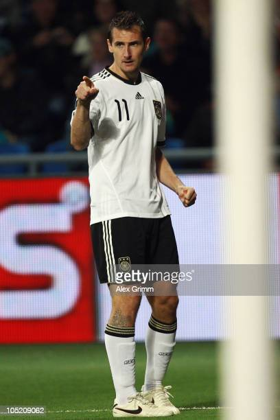 Miroslav Klose of Germany celebrates his team's first goal during the EURO 2012 group A qualifier match between Kazakhstan and Germany at the Astana...